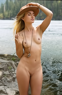 Anna Katarina gets naked and plays music at the lake